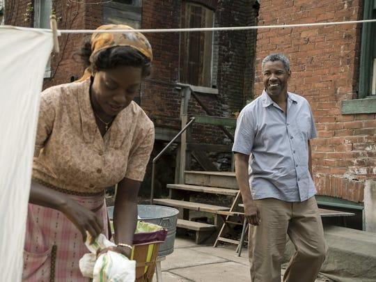 "Viola Davis and Denzel Washington in ""Fences."""