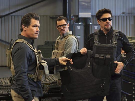 """Josh Brolin, from left, Jeffrey Donovan and Benicio Del Toro star in """"Sicario: Day of the Soldado"""""""