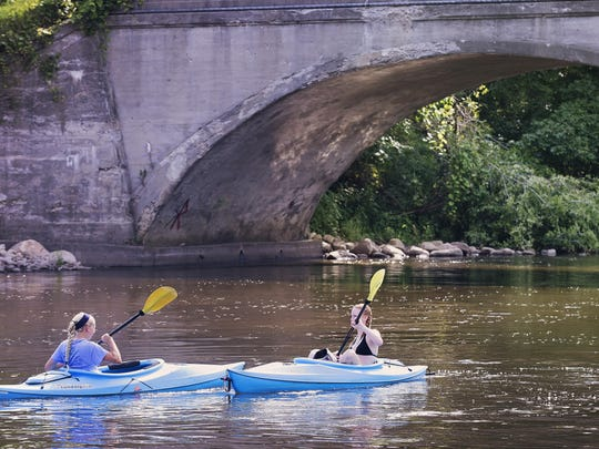 Claire LeRoux and Naomi Davis of Pennfield kayak from a launch site in Ceresco.