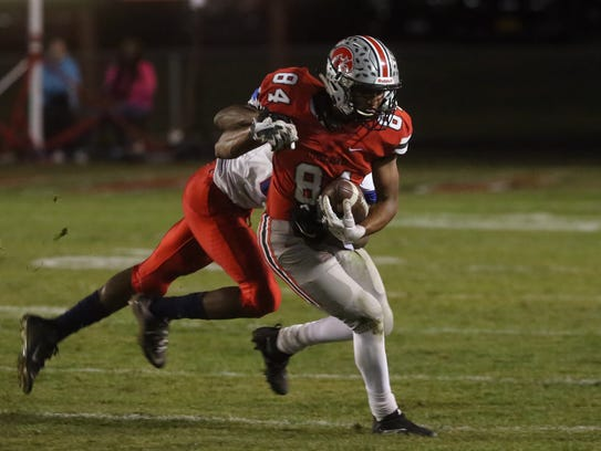 City High's Zach Jones fights for extra yards during