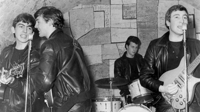 The Beatles perform onstage at the Cavern Club in February 1961 in Liverpool, England. George Harrison, left, Paul McCartney, Pete Best and John Lennon.