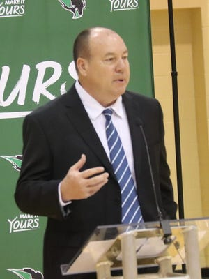 New Oklahoma Baptist University women's basketball coach Bo Overton speaks to a gathering at a Monday press conference at the Noble Complex.