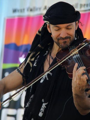 Scott Jeffers, the lead vocalist and violinist of Traveler, a Phoenix-based World Fusion band, performs at last year's Lakeside Music Fest. This year's festival features 13 new bands from Celtic rock to Bluegrass.