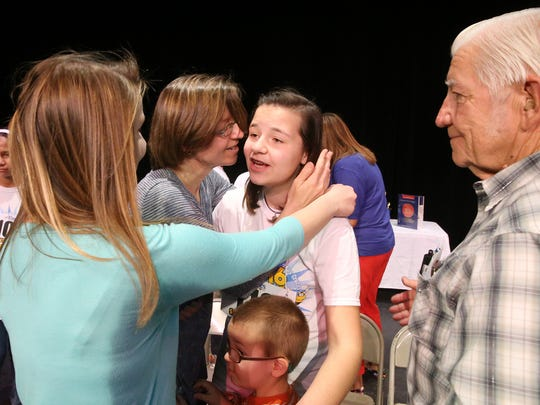 Kate Spitzer is congratulated by her family after winning the 2016 El Paso Times Spelling Bee. Abigail Spitzer, second from left, who won the spelling bee three times, was one of the first to congratulate her younger sister. Their mother, Tabitha Spitzer, is at Kate's left. Also shown are Kate's grandfather, the Rev. Julius Martin, and her younger brother, Kolbe Spitzer. See more photos at elpasotimes.com.
