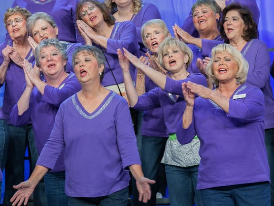 Sweet Adelines competing in international competition in 2014. The organization has been competing for the world title every other year since it was established.