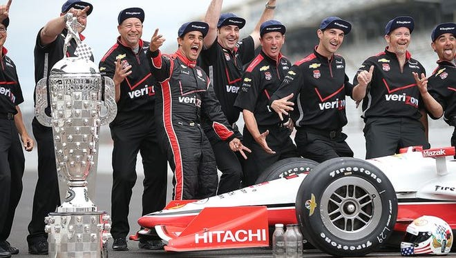 Juan Pablo Montoya and his crew pose for photos on May 25, 2015, the day after winning the 99th running of the Indianapolis 500. Major festivities are planned for the 100th running of the race in May 2016.