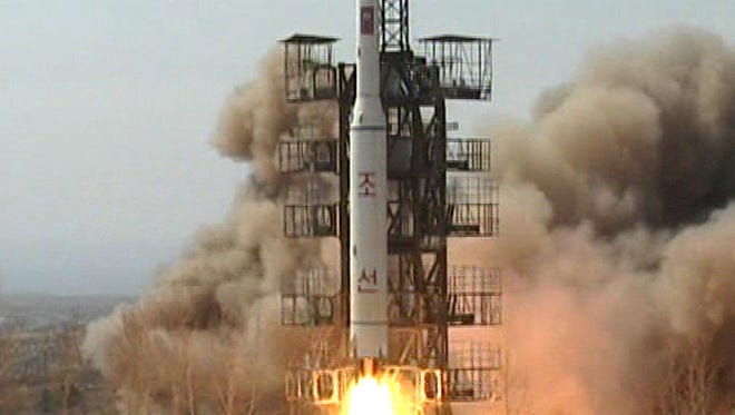 In this April 5, 2009 image made from KRT video, a rocket is lifted off from its launch pad in Musudan-ri, North Korea.