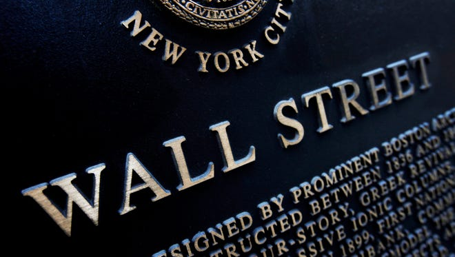 This Jan. 4, 2010 file photo shows an historic marker on Wall Street in New York. U.S. financial markets eased back from record highs in early trading Wednesday, Feb. 25, 2015.