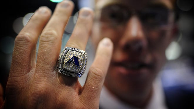 ASU golfer Carter Newman shows his champions ring after a banquet in honor of the ASU Men's Golf team at Christenberry Fieldhouse Thursday evening  August 19, 2010.  MICHAEL HOLAHAN/staff