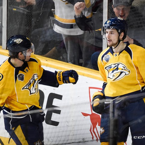 Craig Smith (15), Filip Forsberg and the Predators are 25-21-8 with nine games left before the NHL's Feb. 29 trade deadline.