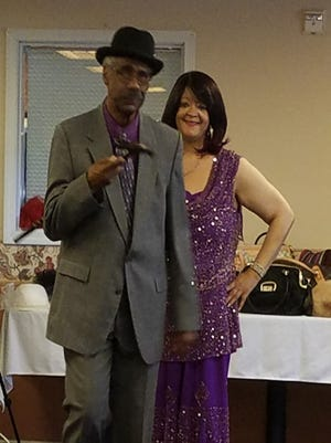 Mildred Kennedy and Gerald Belcher are ready for a night on the town in their evening wear.
