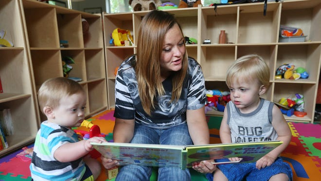 Lisa Pryor reads to her sons, Jace, 10 months, and Chance 2, at LifeHouse Crisis Maternity Center. 'If it wasn't for LifeHouse, I don't know where I'd be,' Pryor says.