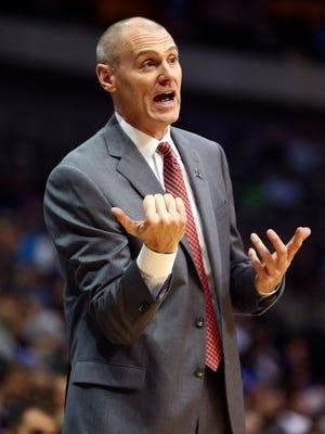 Dallas Mavericks coach Rick Carlisle works against the Denver Nuggets.