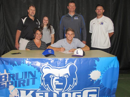 Ethan Eldridge (center) signs a National Letter of Intent to play baseball at Kellogg Community College. From left to right are Todd Eldrige, Glory Eldridge, Lauren Eldridge, Ethan Eldridge, head KCC baseball coach Eric Laskovy and Lakeview High School baseball assistant coach Kyle Kracht.