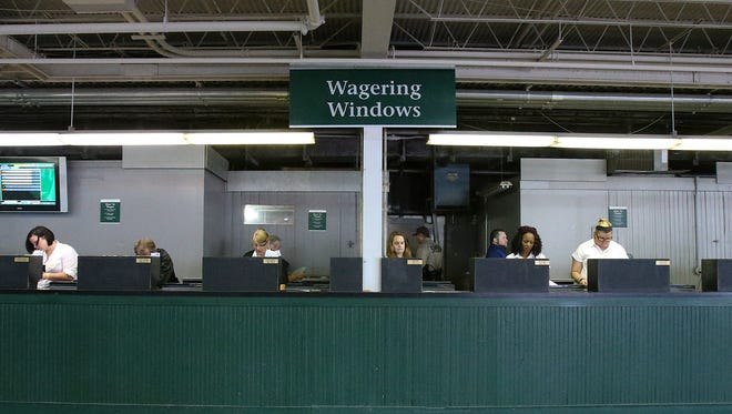 Mutuel tellers prepare for customers at Churchill Downs.May 7, 2016