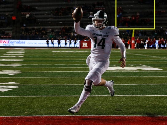 Michigan State's Brian Lewerke runs in for a touchdown