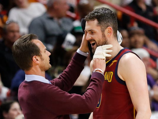 Cleveland Cavaliers center Kevin Love (0) is attended to after a first quarter injury during play against the Miami Heat in an NBA basketball game, Tuesday, March 27, 2018, in Miami. The Heat won the game 98-79. (AP Photo/Joe Skipper)