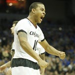 Bearcats guard Troy Caupain reacts after a made basket Thursday against Purdue.