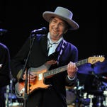 Bob Dylan, left, and Eric Clapton perform for a sold out crowd at New York's Madison Square Garden on June 30, 1999.