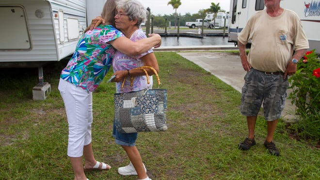 Carolyn Morrissette, left, one of the owners of San Carlos RV Park, hugs Jill Bodeau as Bodeau and her husband, Paul, prepare to go home.