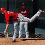 Reds pitcher Sean Marshall follows through on a pitch during practice Feb. 18 in Goodyear.