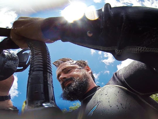 """Ben Maddox dons his mask and snorkel as he prepares to search for fish to video record near Woods Island off of Hathaway Point in St. Albans on July 17. Maddox combines his video footage with his music for a video series called """"I See Fish People"""" that he posts on YouTube."""