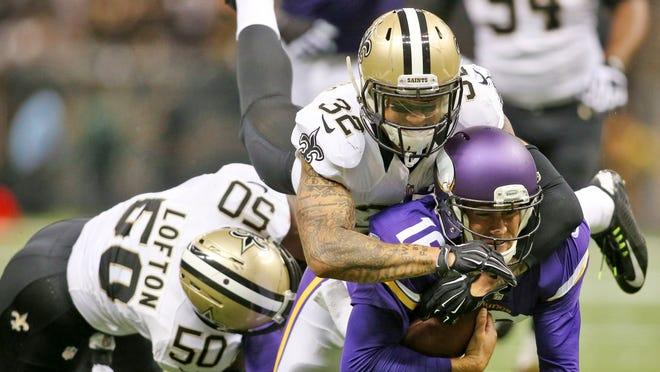 New Orleans Saints strong safety Kenny Vaccaro (32) is shown making a tackle with middle linebacker Curtis Lofton of Minnesota Vikings quarterback Matt Cassel earlier this season.