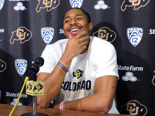 Colorado junior point guard Spencer Dinwiddie announces that he will skip his senior season and declare for the NFL basketball draft, Thursday, April 24, 2014, in Boulder, Colo. (AP Photo/Daily Camera, Cliff Grassmick) NO SALES