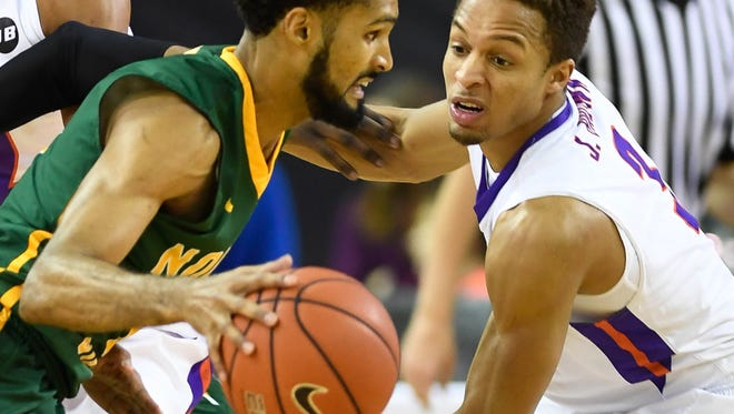 Evansville's Jaylon Brown guards Norfolk State's Jonathan Wade in the first period as the University of Evansville Purple Aces play the Norfolk State Spartans at the Ford Center in Evansville Wednesday, December 14, 2016.