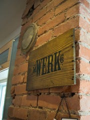 A sign for M. Werk Co. hangs inside Barrett Evans and