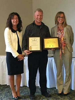 From left, Karen Nichols, executive director of the Chamber of Manitowoc County; and Manitowoc Mayor Justin Nickels accept awards from Meredith Dressel, DVR Bureau Director of Consumer Services, during a recent ceremony at the Lighthouse Inn in Two Rivers. The event was held in conjunction with National Disability Employment Awareness Month.