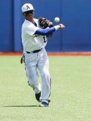Angelo State's Jonathan Soberanes throws the ball back