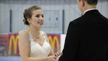 Couple weds at center ice wearing hockey skates