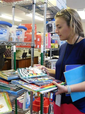 From last year, a beginning teacher selects items for the school year from the Beginning Teachers Cottage
