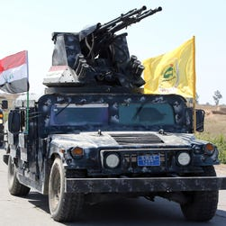 Members of the Iraqi security forces heading from the city of Samarra north of Baghdad drive towards al-Dawr area south of Tikrit to launch an assault against the Islamic State group.