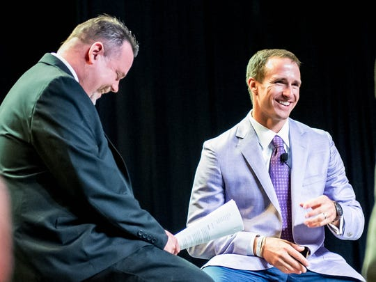 Kevin Foote, the Daily Advertiser's sports engagement editor, speask to Drew Brees at the 2016 Best of Prep banquet held at the Cajundome Convention Center on Tuesday night May 17, 2016.