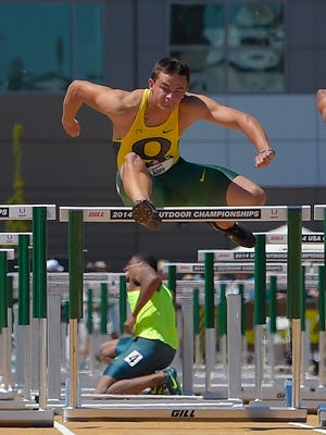 Ronnie Ash, below, kneels after going down as Devon Allen clears his last hurdle to win the men's 100 meter hurdles final at the U.S. outdoor track and field championships, Sunday, June 29, 2014, in Sacramento, Calif.