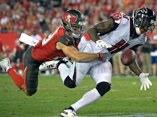 Tampa Bay Buccaneers free safety Chris Conte, left, breaks up a pass intended for Atlanta Falcons wide receiver Julio Jones (11) during the second half of an NFL football game, Monday, Dec. 18, 2017, in Tampa, Fla. (AP Photo/Phelan M. Ebenhack)