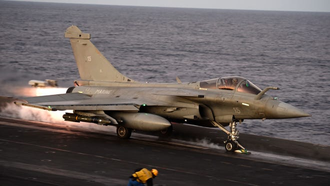 A Rafale fighter jet takes off from the deck of France's Charles de Gaulle aircraft carrier, used in the U.S.-led operation against the Islamic State in theMediterranean Sea, on Dec. 9, 2016.