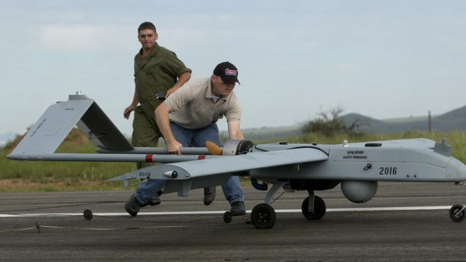 In this Sept. 8, 2005, file photo, US Army Sgt Joshua Clark, left, and maintenance instructor Richard Peebles catch a Shadow 200, an unmanned aerial vehicle, or UAV, as it touches down after a test flight at Fort Huachuca, outside Sierra Vista, Ariz. A Shadow drone similar to this one that disappeared on a training flight in southern Arizona nine days earlier was found Thursday in Colorado.