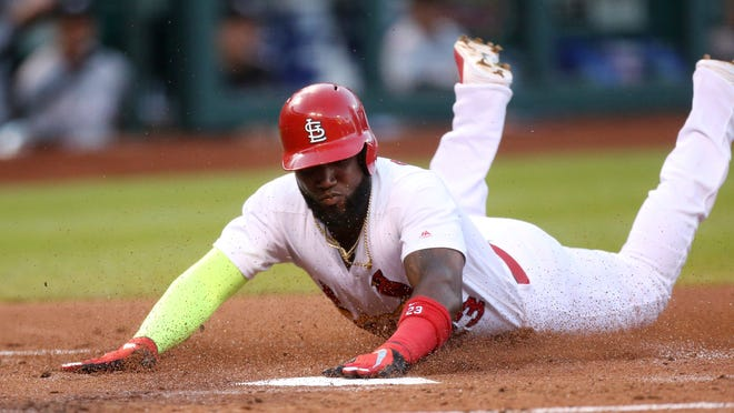 St. Louis Cardinals' Marcell Ozuna scores on a single by Yadier Molina in the second inning against the Miami Marlins in a baseball game Tuesday, June 5, 2018, in St. Louis. (Chris Lee/St. Louis Post-Dispatch via AP)