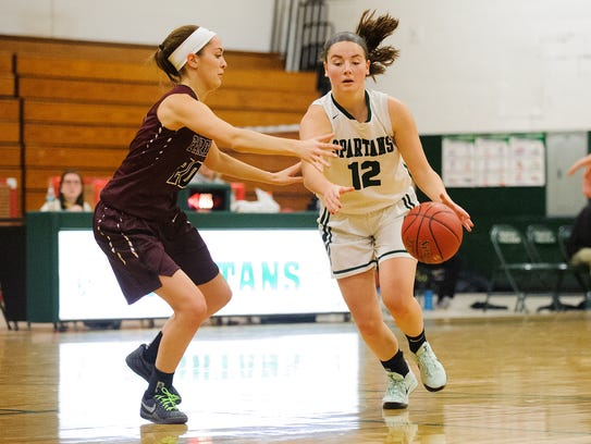 Winooski's Lydia Nattress (12) drives to the hoop past