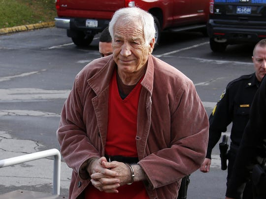 FILE - In this Oct. 29, 2015, file photo, former Penn State University assistant football coach Jerry Sandusky arrives at the Centre County Courthouse in Bellefonte, Pa., for a hearing about his appeal. Judge John Foradora, handling the pending re-sentencing of Sandusky, is recusing himself, citing an unspecified recent action by the attorney general's office. (AP Photo/Gene J. Puskar, File)