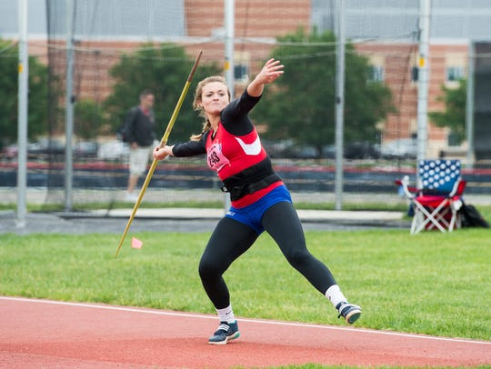New Oxford's Madison Smith competes in the javelin
