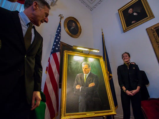 Gov. Peter Shumlin and his wife Katie Hunt unveil his official portrait after delivering his farewell address at the Statehouse in Montpelier on Wednesday, January 4, 2017.  The portrait was painted by August Burns.