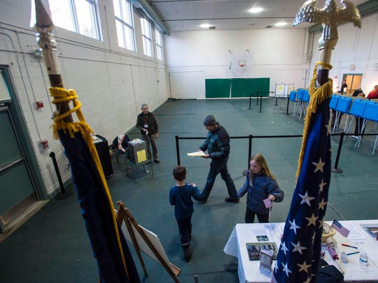 Voters cast their ballots at the Shelburne Town Gymnasium