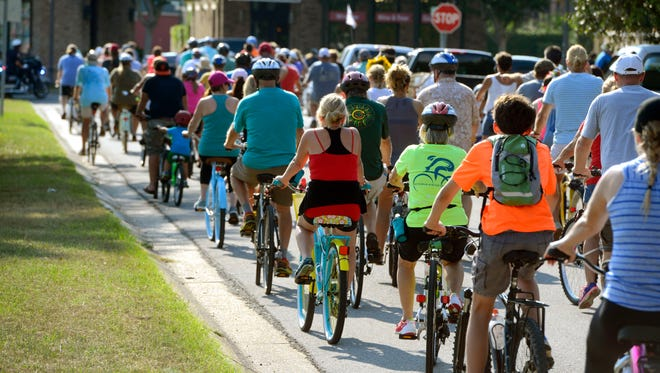 Bike riders take off from Gulf Power during the Bike Pensacola Slow Ride Saturday, September 23, 2017. The nearly six mile ride is a leisurely ride through the historic and downtown districts of Pensacola open to bike riders of all skill levels.
