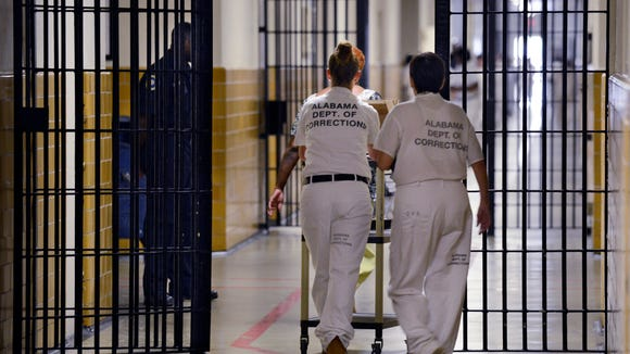 Inmates moving through a hallway at Tutwiler Prison for Women on Wednesday, Sept. 4, 2013. (Montgomery Advertiser, Lloyd Gallman)