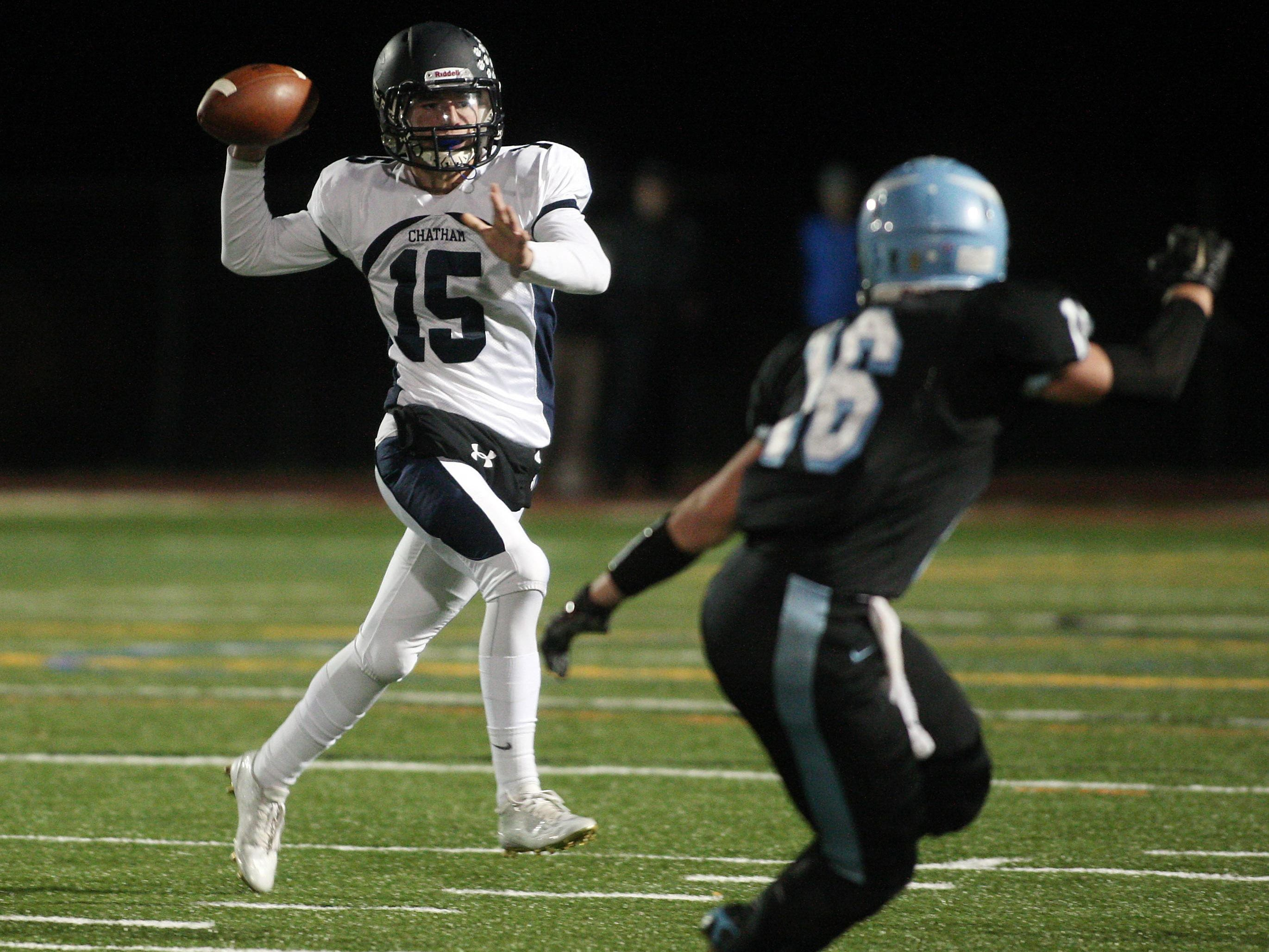 Chatham quarterback Alex Sands throws for a first down vs defending sectional champion Parsippany Hills in a showdown with playoff implications. October 30, 2015, Parsippany, NJ.
