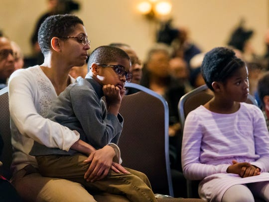 Six year-oldJacob Allen sits on his mother Raina's lap as he listens to Rep. John Lewis speak at a town hall meeting at the DoubleTree Hotel in Wilmington Friday afternoon.